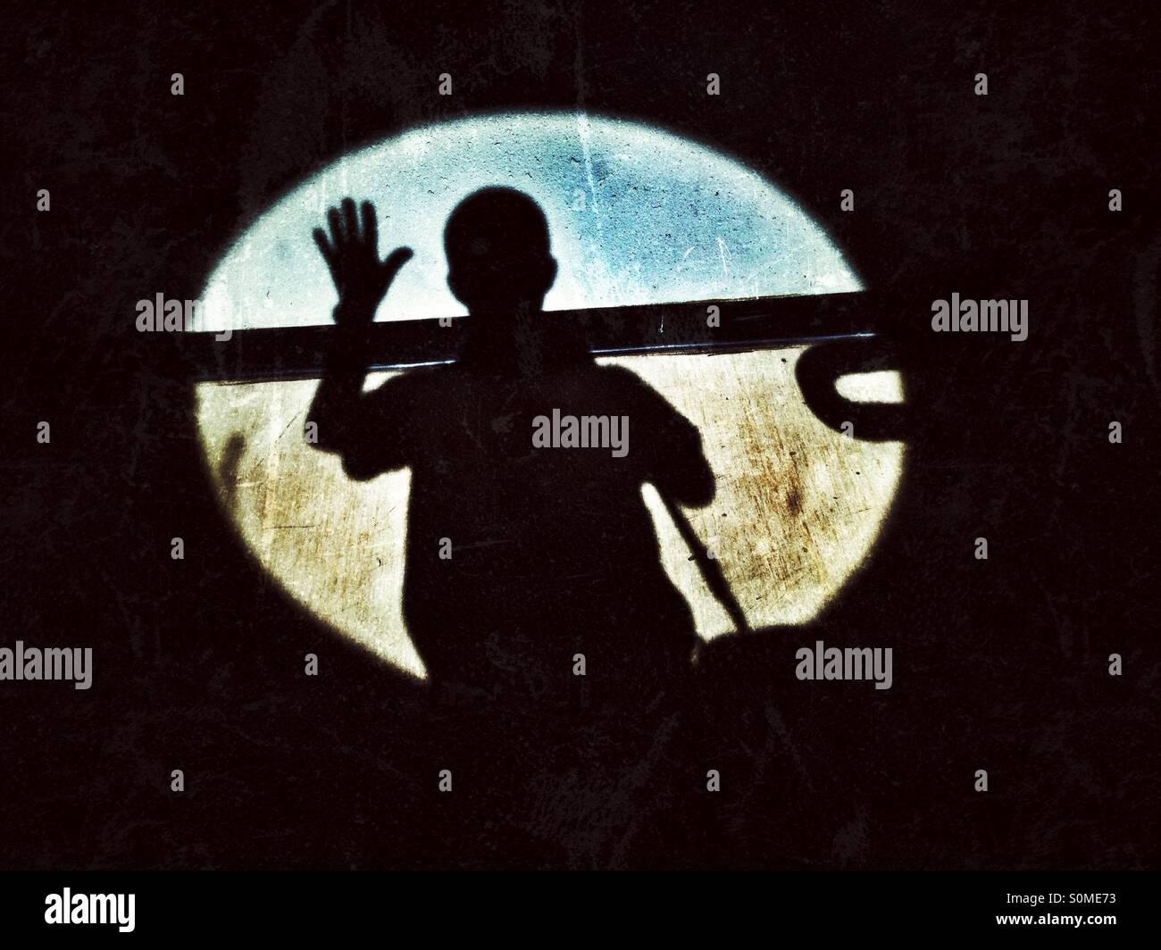 Shadow of a man waving. - Stock Image