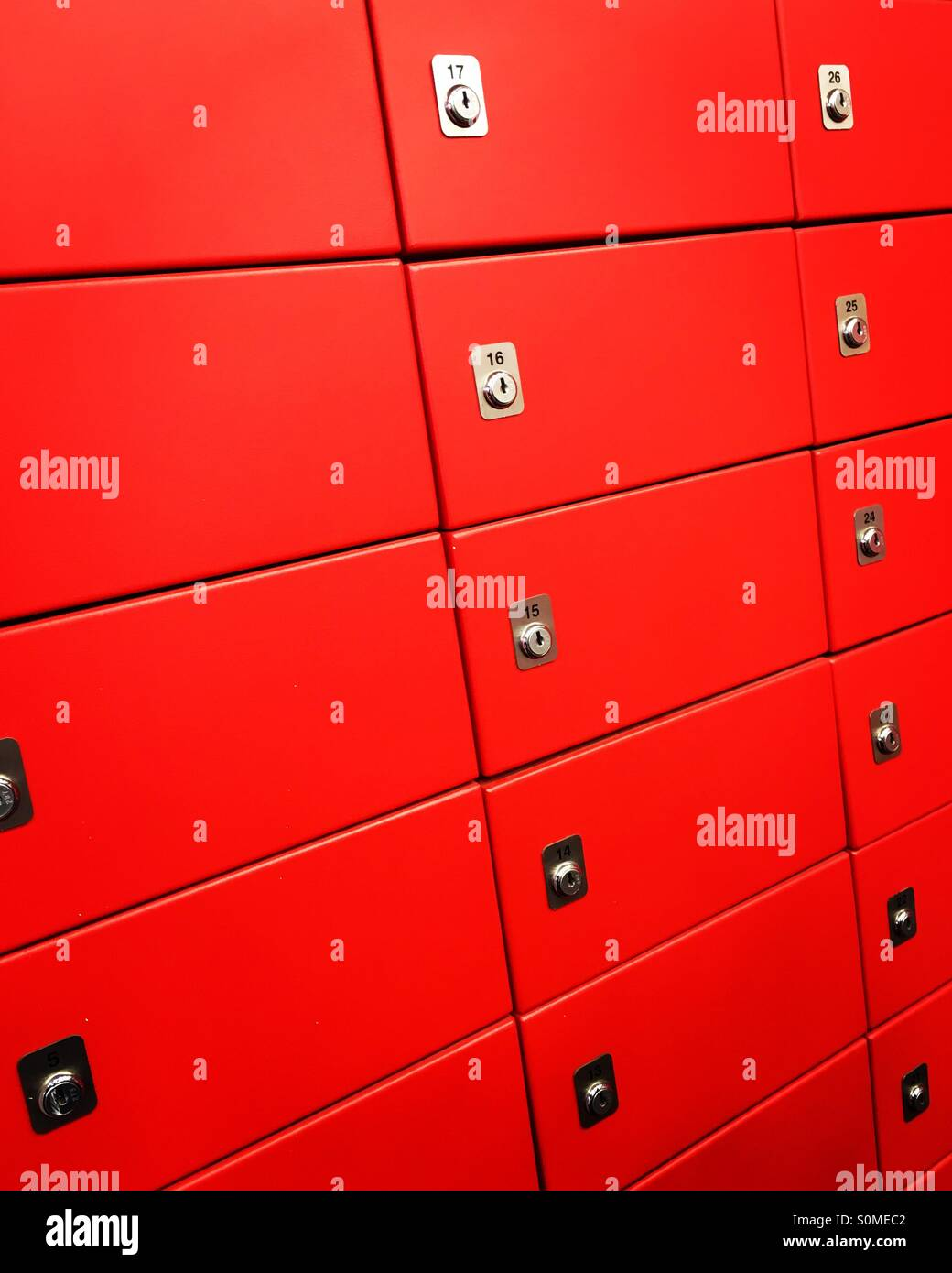 Numbered red safety deposit boxes. - Stock Image