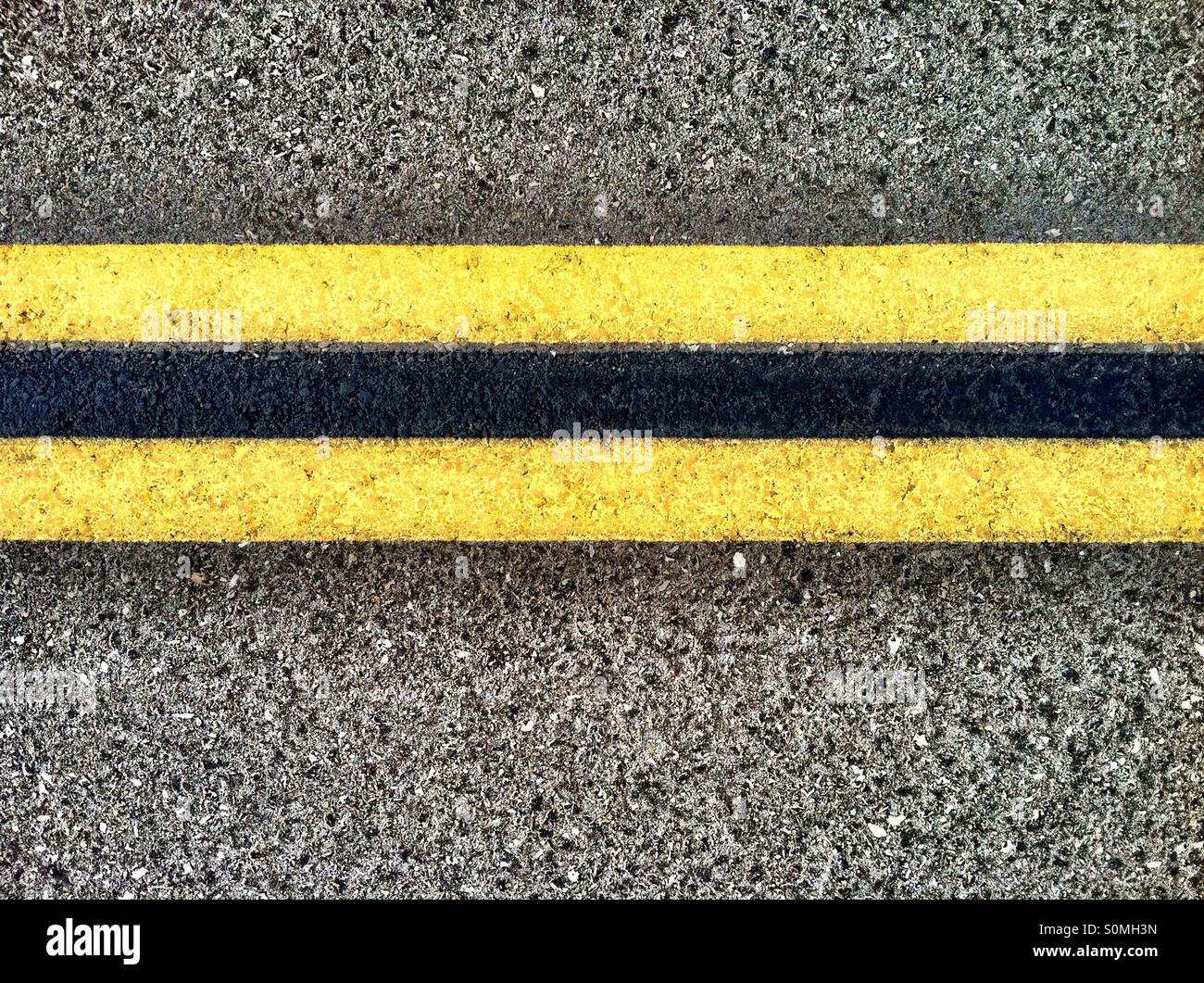 Double yellow lines on Highway - Stock Image