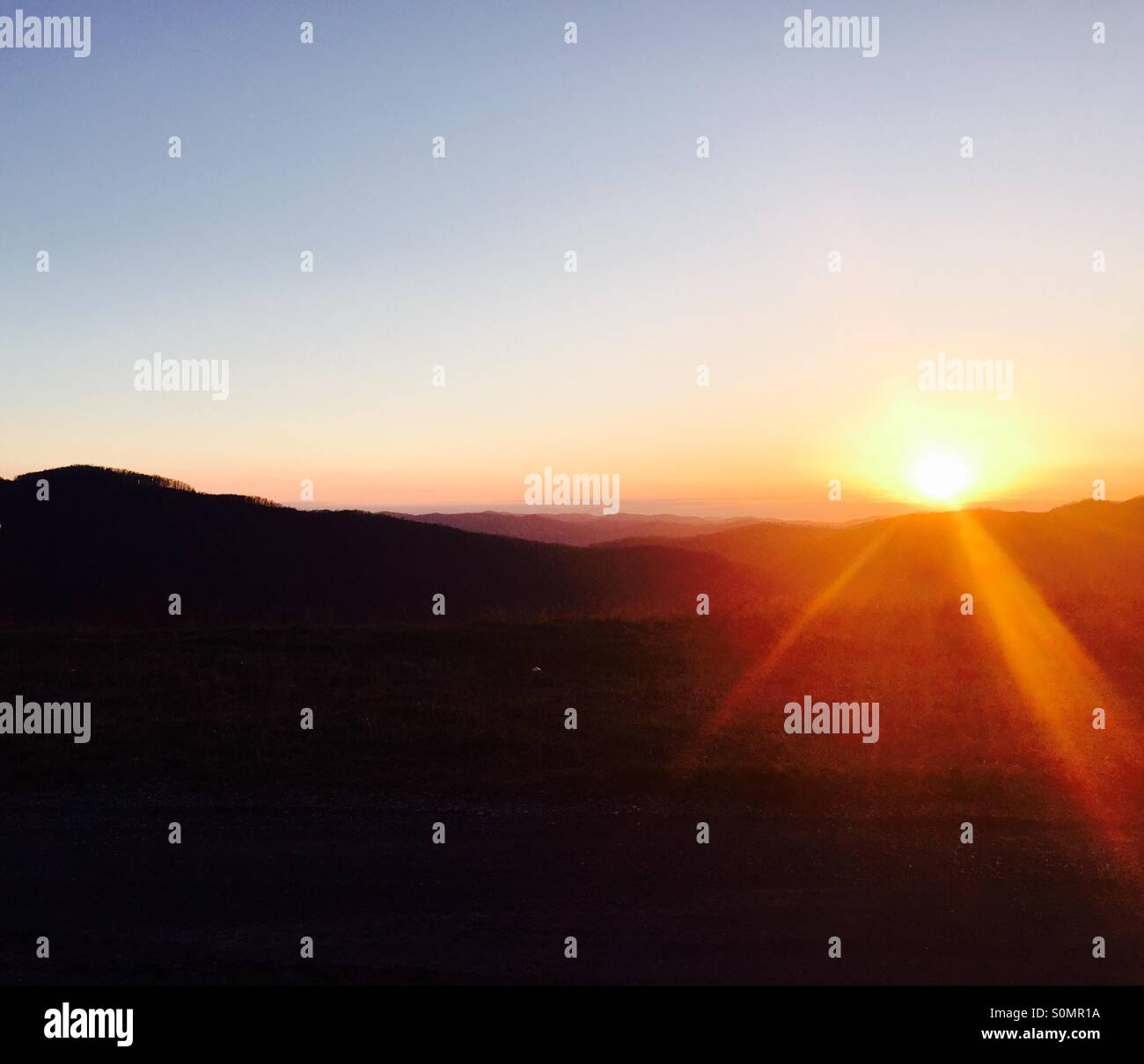 Sunsetting on the mountains - Stock Image