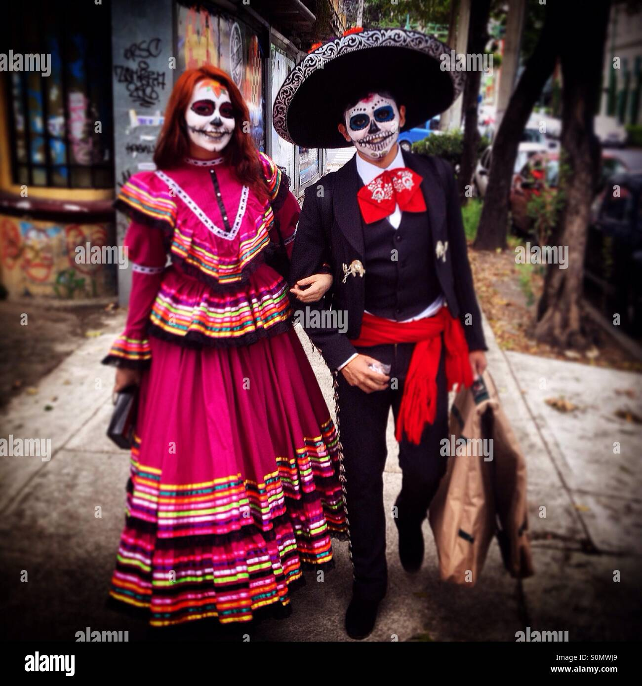 A couple of Mexicans dressed with traditional costumes for Day of the Dead celebrations walk in a street of Colonia Roma Mexico City Mexico  sc 1 st  Alamy & A couple of Mexicans dressed with traditional costumes for Day of ...