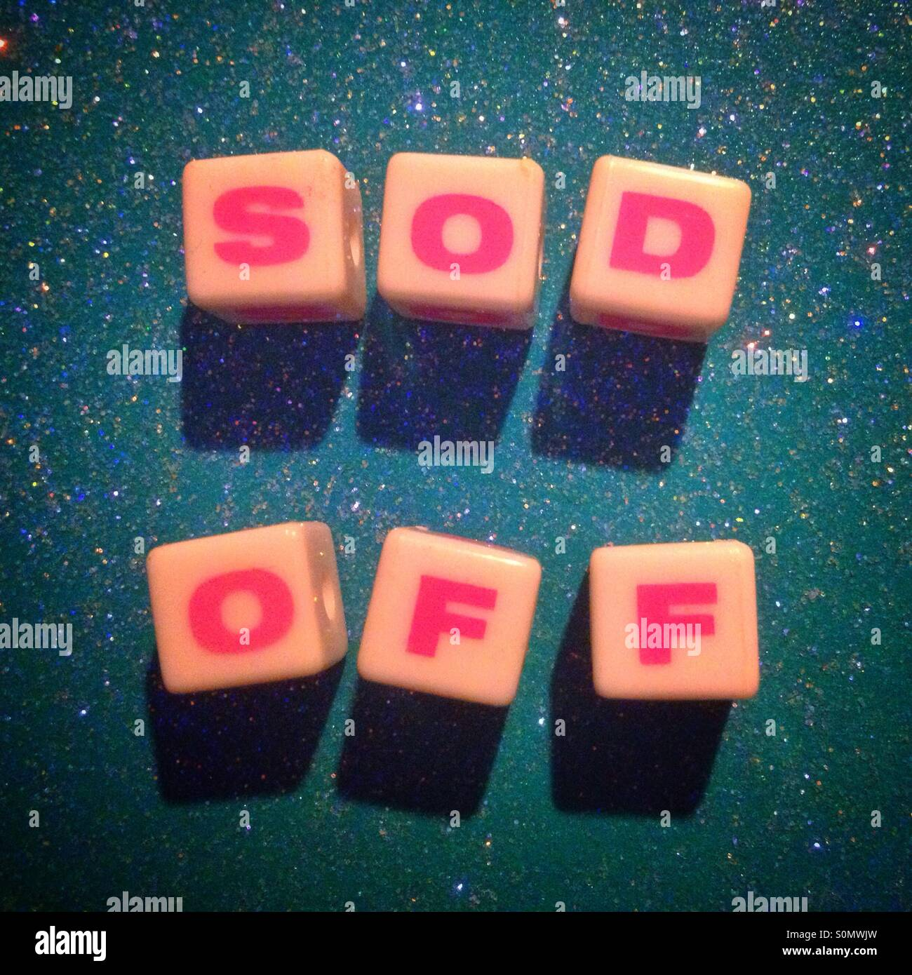 Sod Off spelt out using a child's plastic letter blocks - Stock Image
