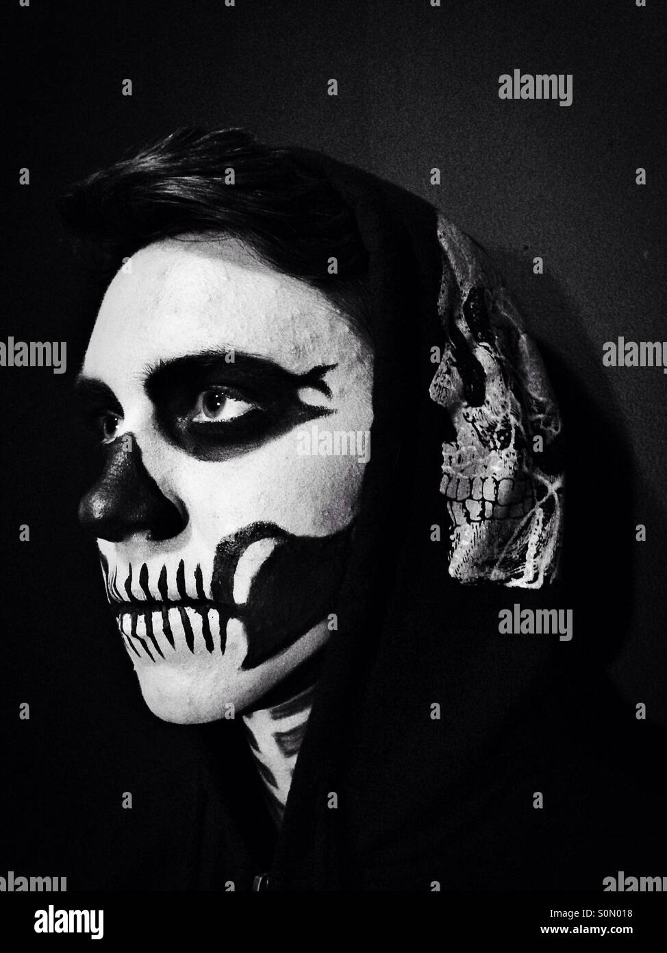 Close up of person with skeleton make-up. - Stock Image