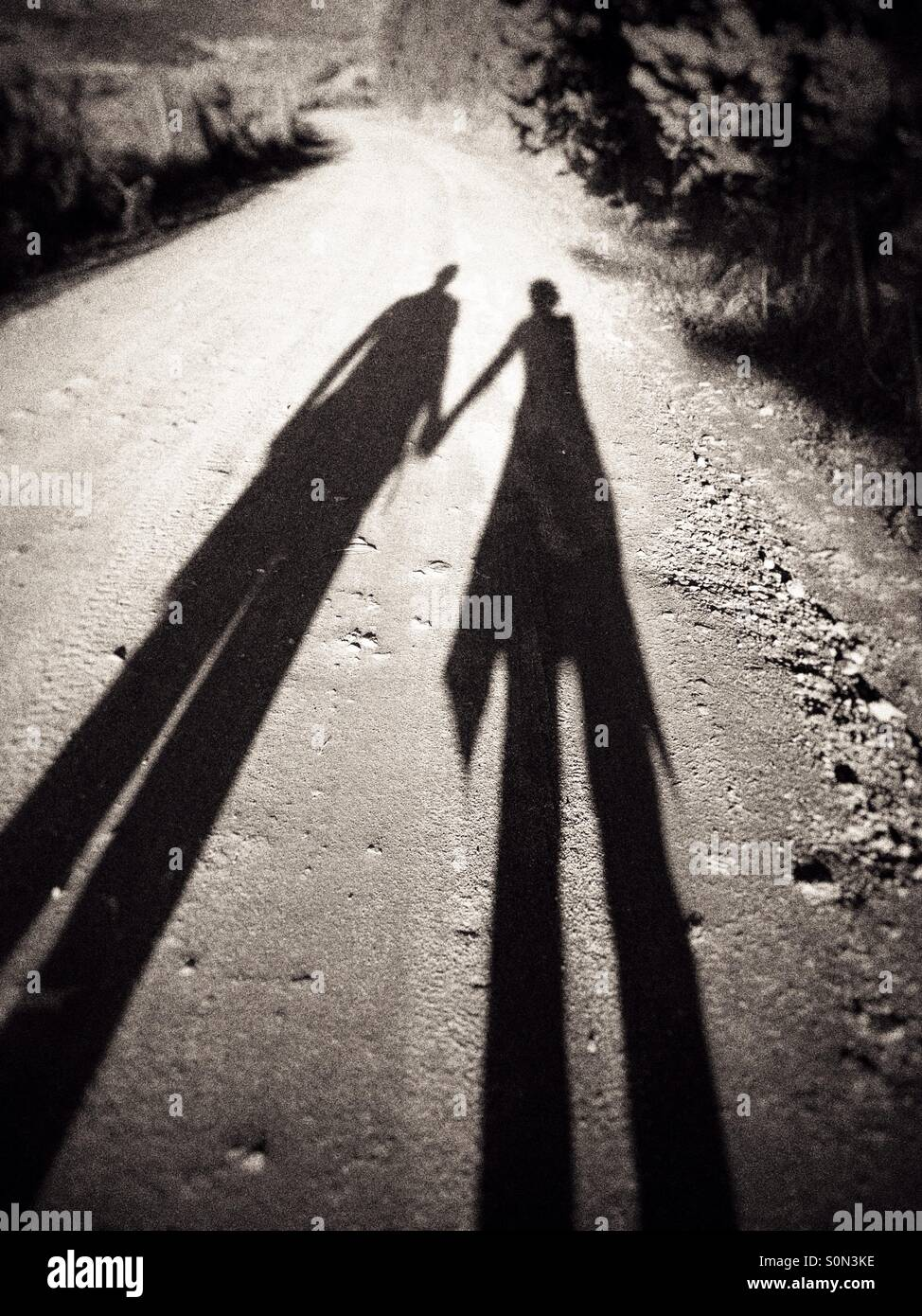 Distorted shadows of two people holding hands Stock Photo  310250514 ... 438153341b