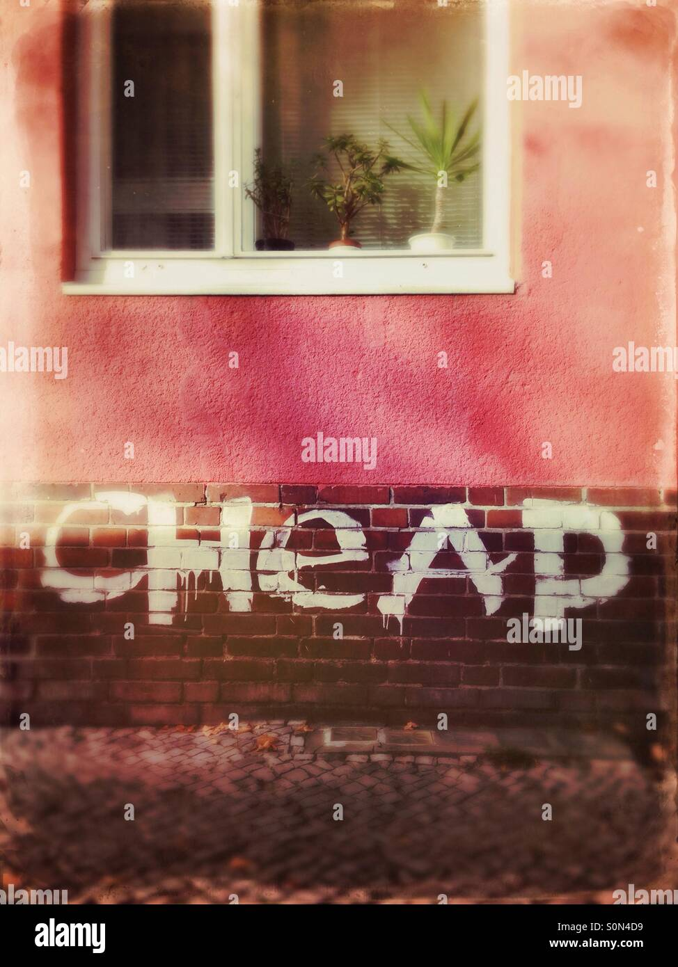Cheap graffiti on a house in the neighbourhood Schillerkiez in Neukoelln, Berlin, Germany - Stock Image