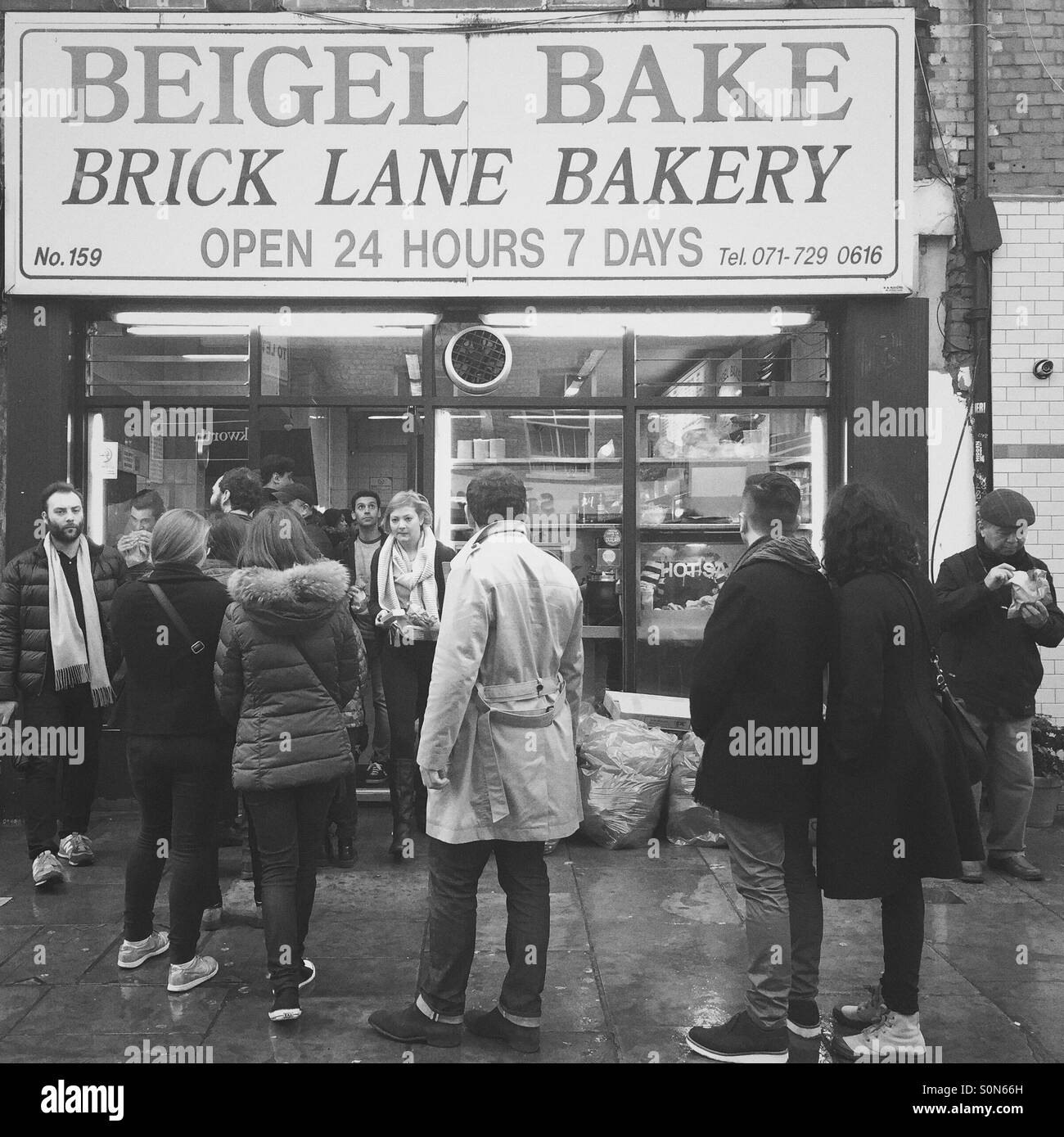 People queueing in front Beigel Bake shop, London, UK Stock Photo