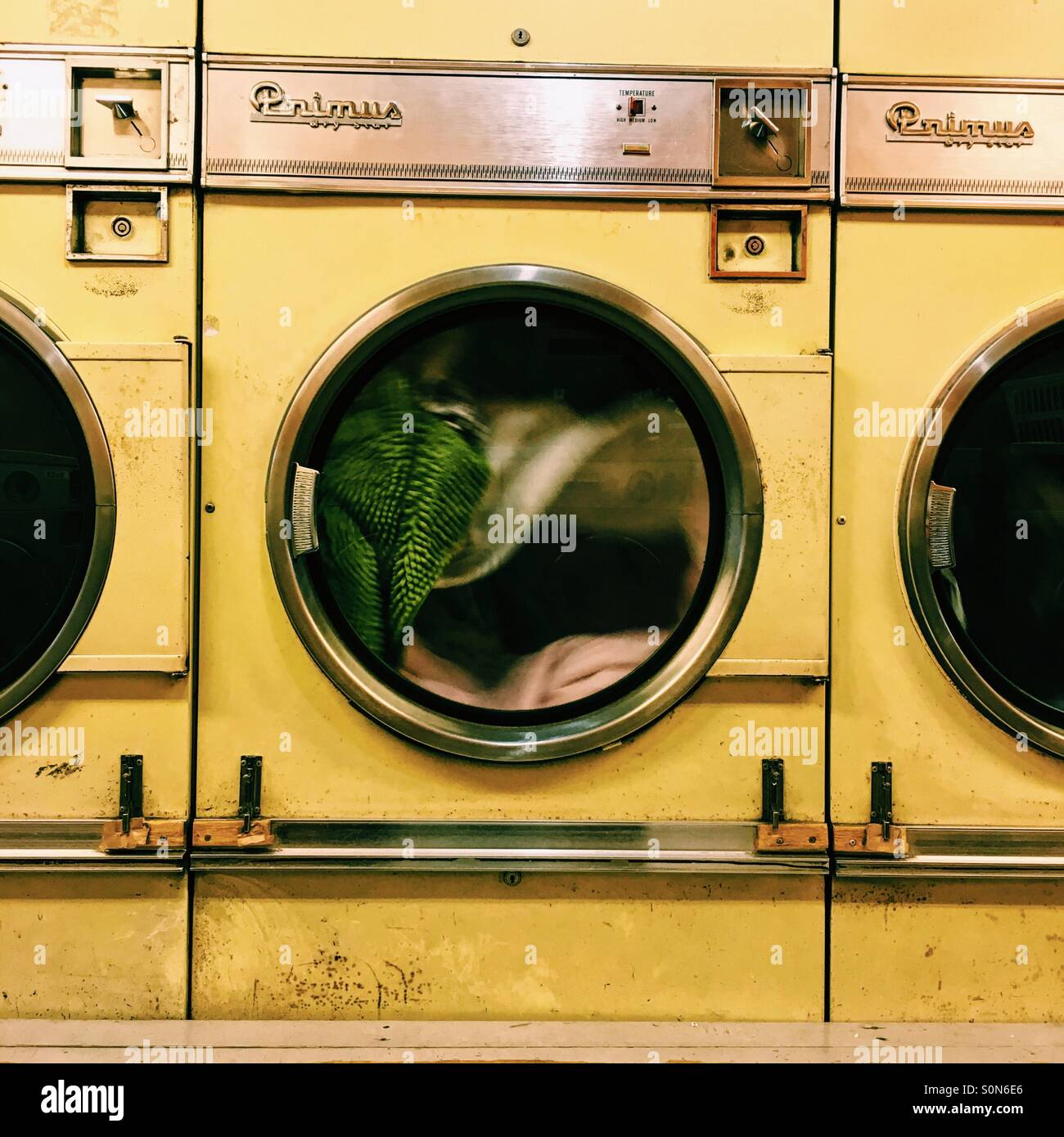 Drying your stuff in a laundrette - Stock Image