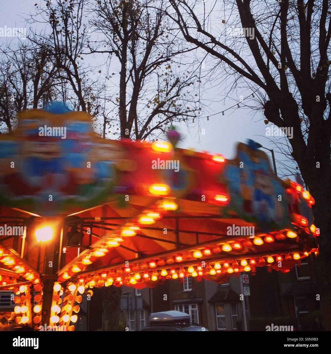Whirling fairground ride - Stock Image
