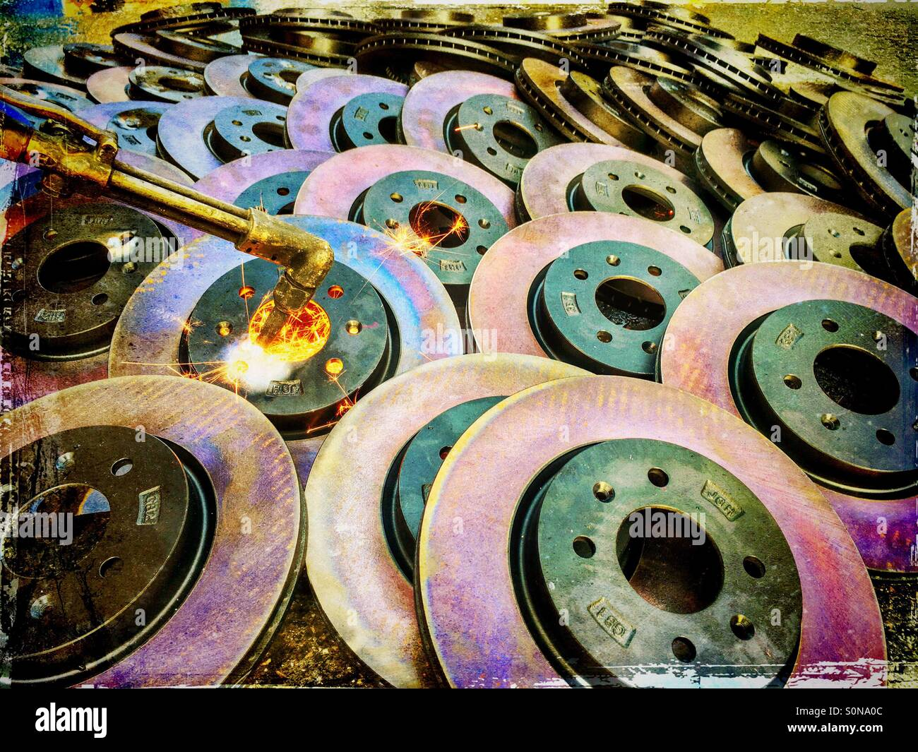 Destroying brake discs by burning and cutting Stock Photo