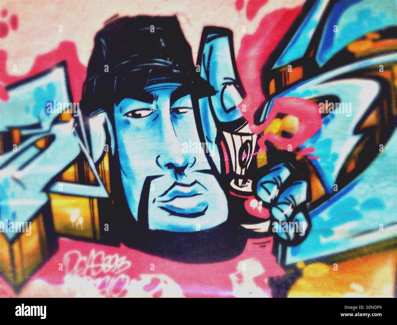 Street art of man with moustache and hat - Stock Image