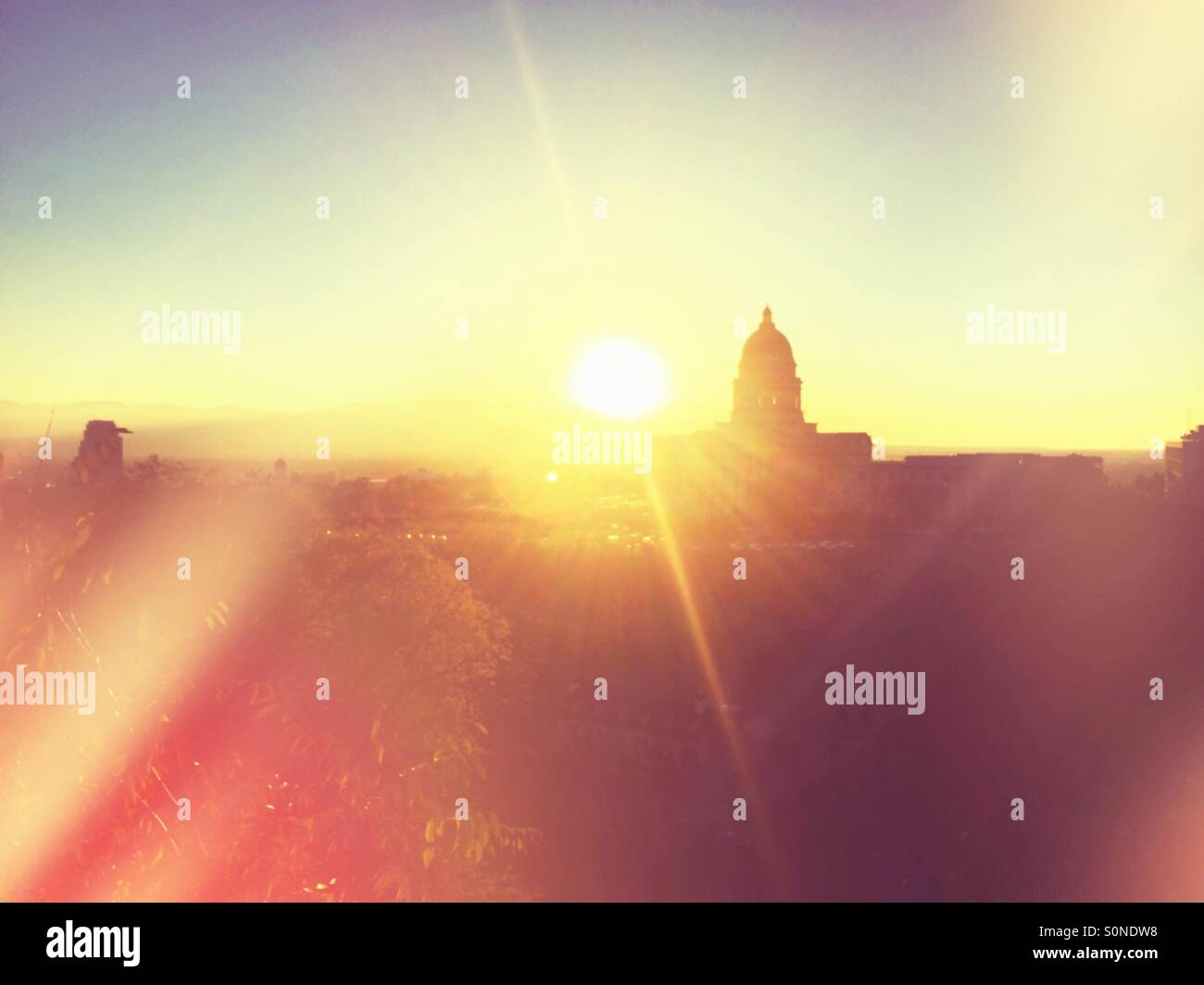 The silhouette of the Utah State Capitol building at sunset. - Stock Image