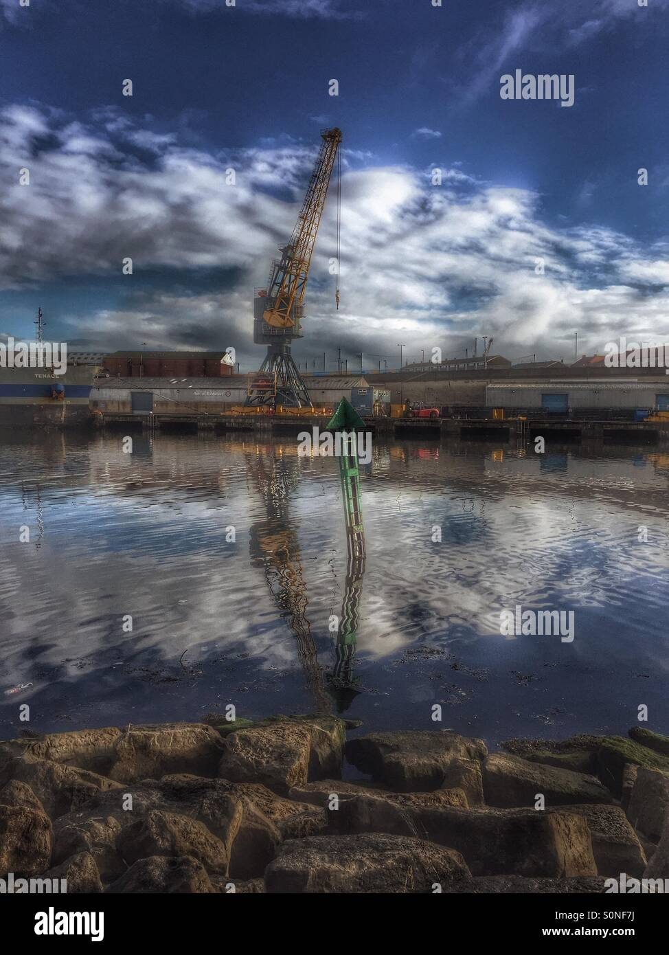 Crane reflections on the river wear - Stock Image