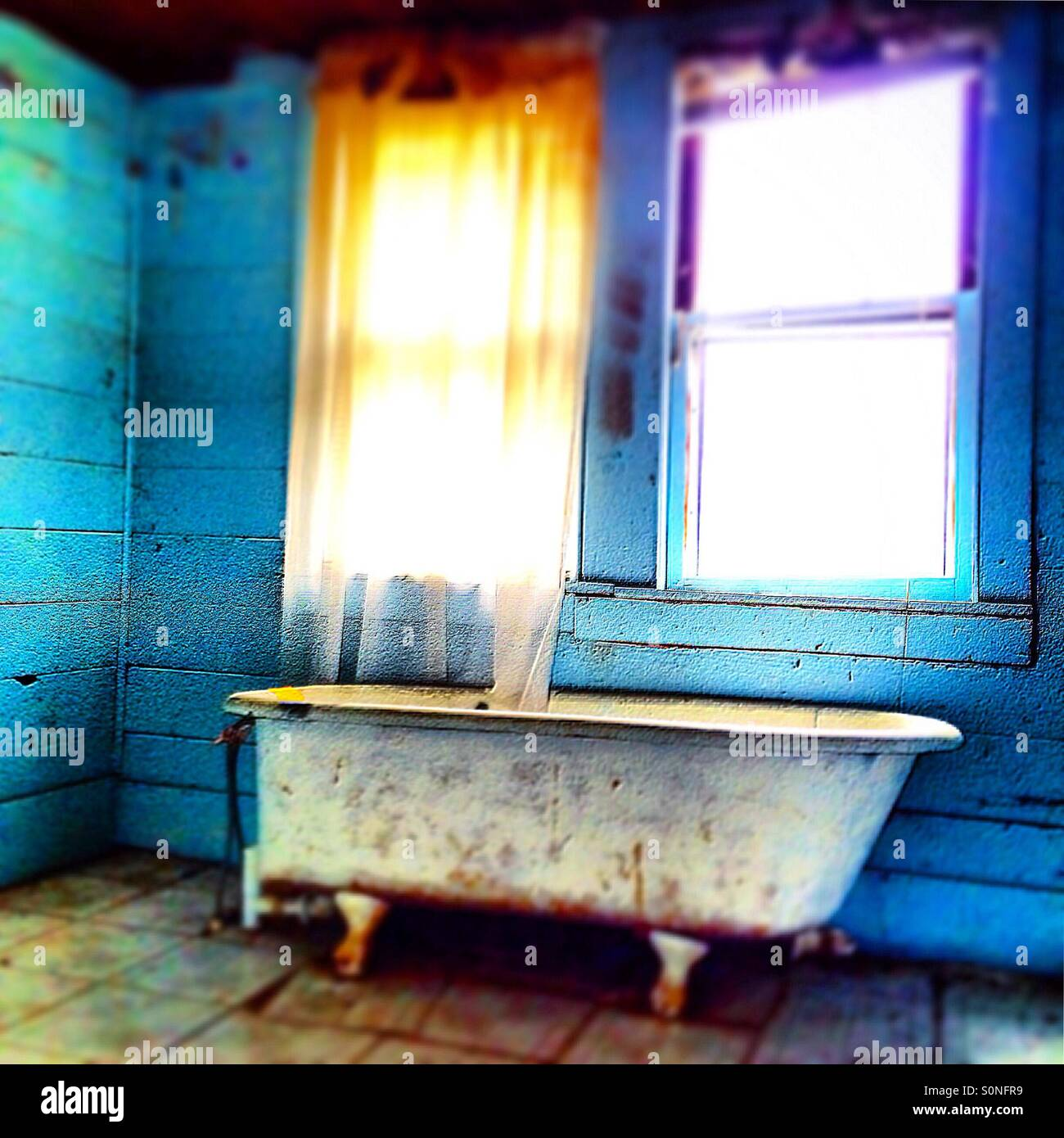 Abandoned bathtub - Stock Image