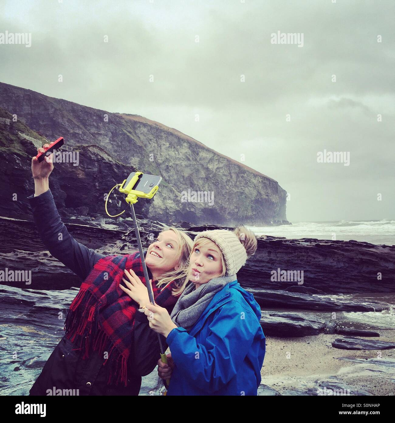 Two girls taking selfies - Stock Image