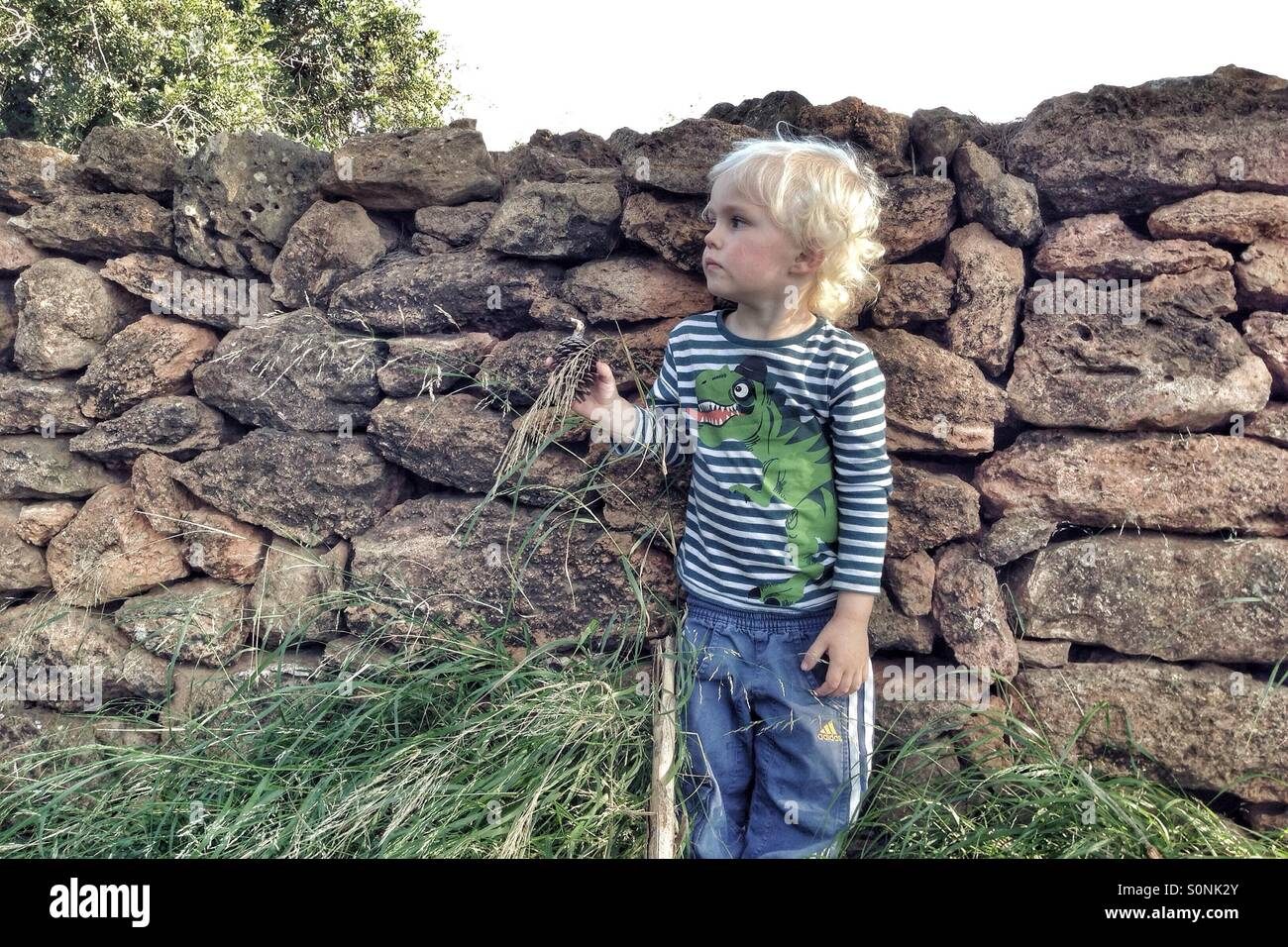 Boy by a wall - Stock Image