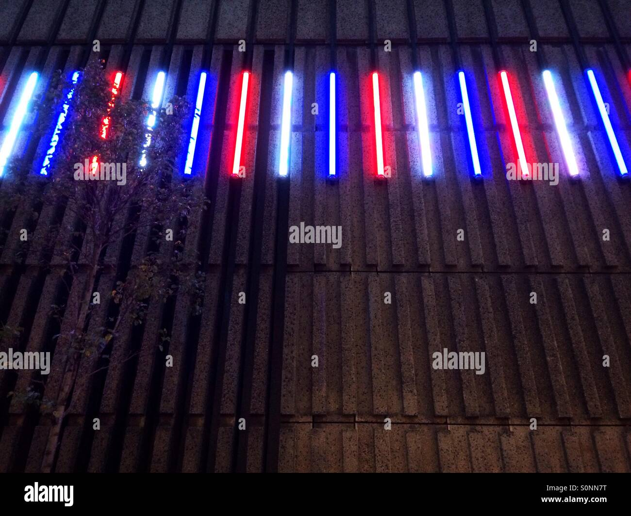 red white blue christmas lights along the side of a building in london uk