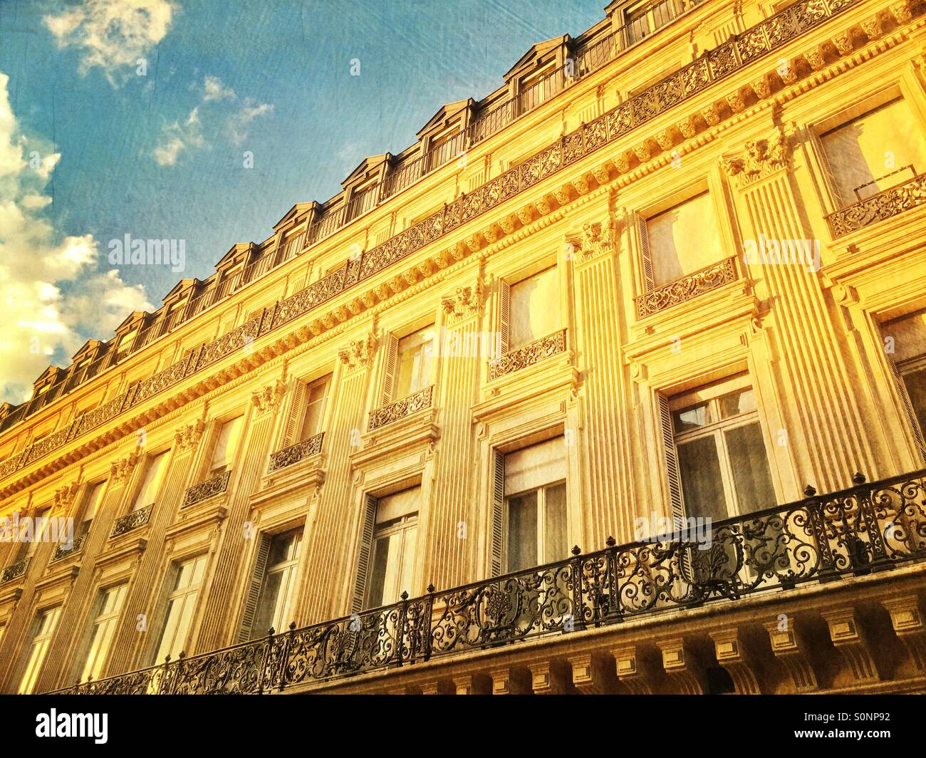 Beautiful old apartment building with classical architecture along Les Grands Boulevards in Paris, France. VintageStock Photo