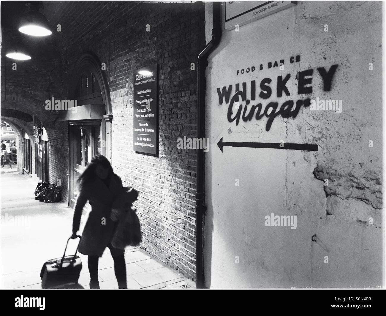 Woman  dragging luggage,London,England - Stock Image