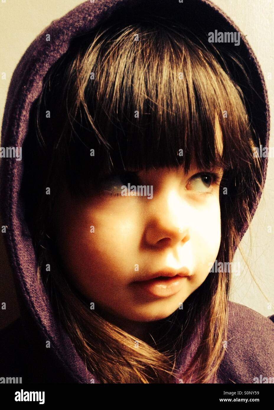 Young girl wearing hooded top - Stock Image
