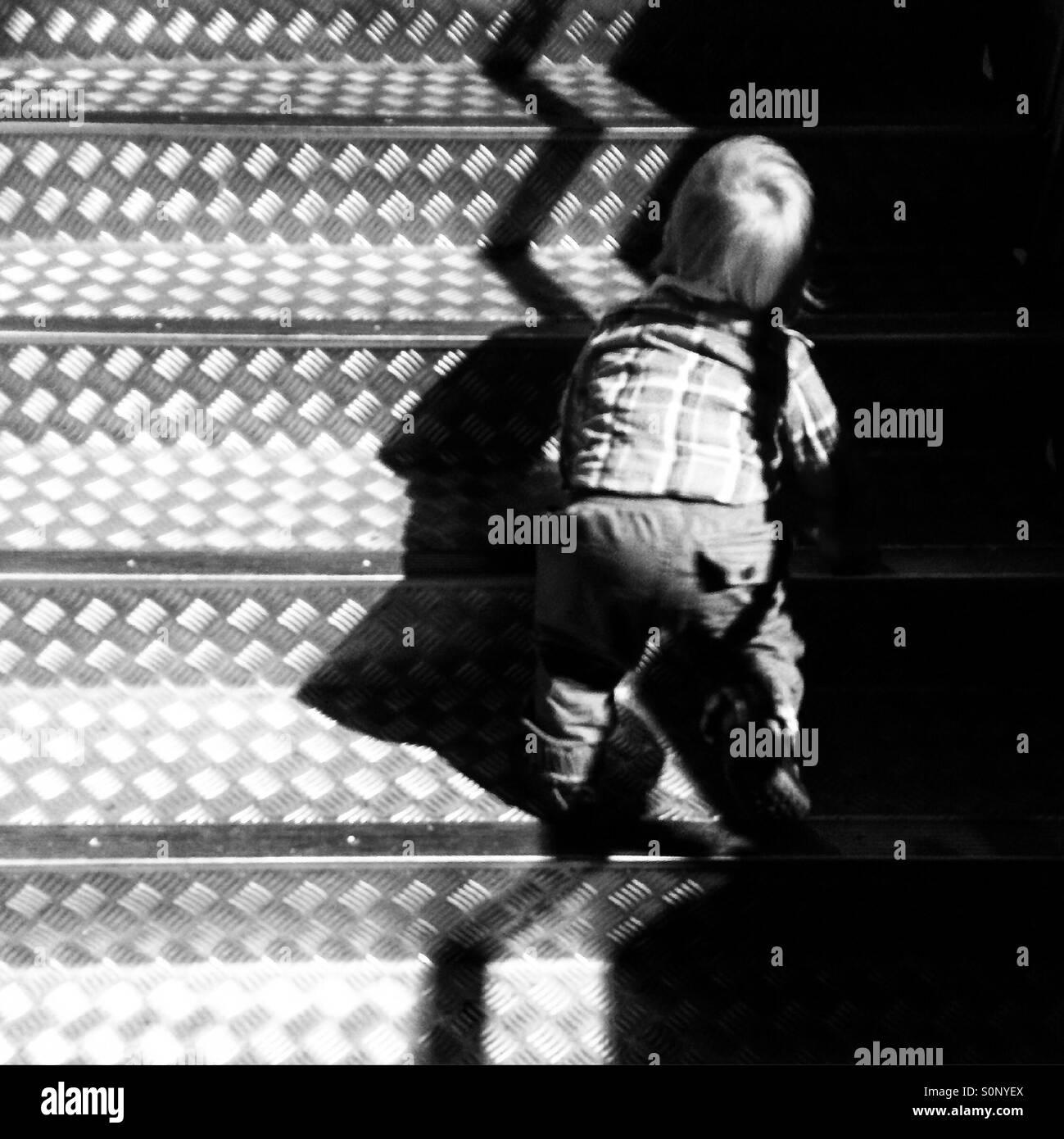 Boy toddler climbing stairs Stock Photo
