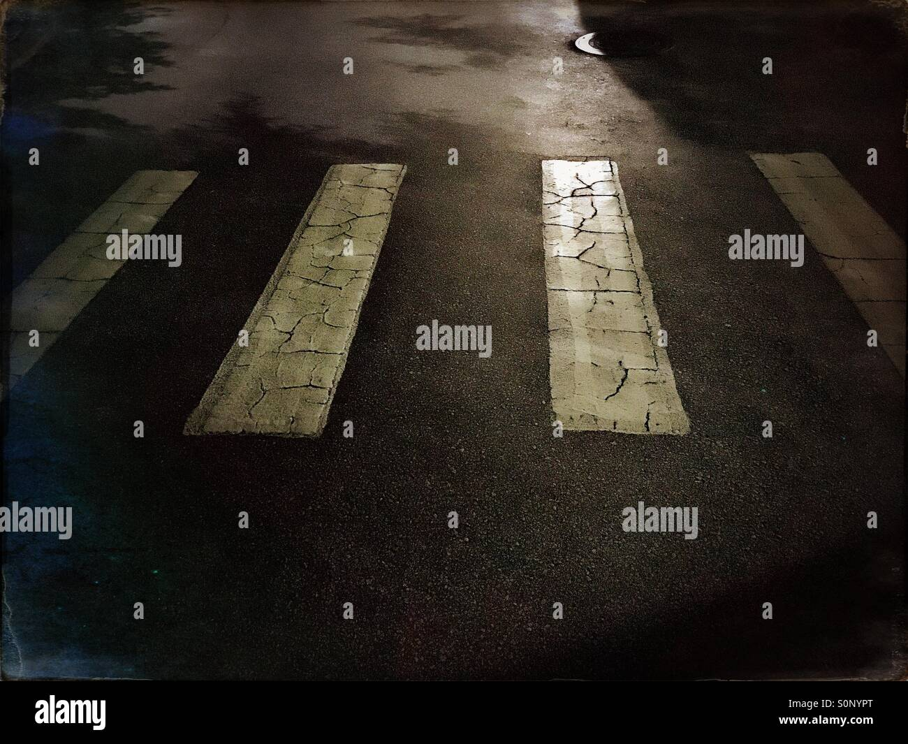 Crosswalk at night - Stock Image