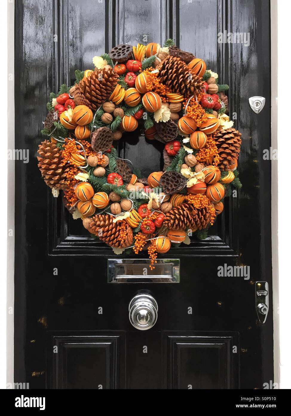 Christmas wreath on a door in Chelsea, England. - Stock Image