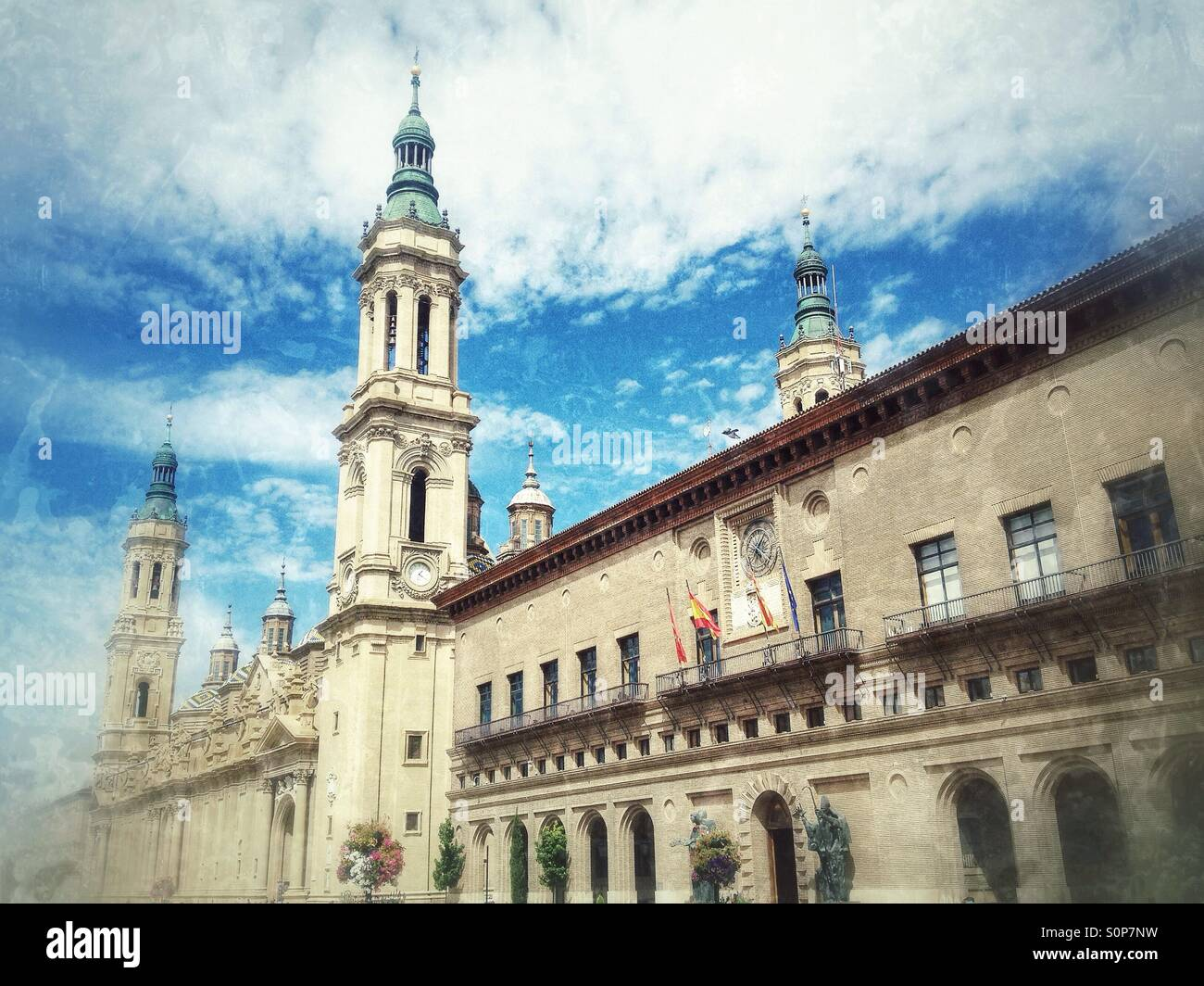 View of the Basilica of Our Lady of the Pillar and the city hall in Zaragoza, Spain - Stock Image