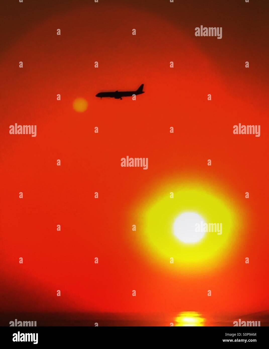 Airlines,airplane,sun,flair,sunset,Mediterranean-sea,water,landing,Beirut,lebanon - Stock Image