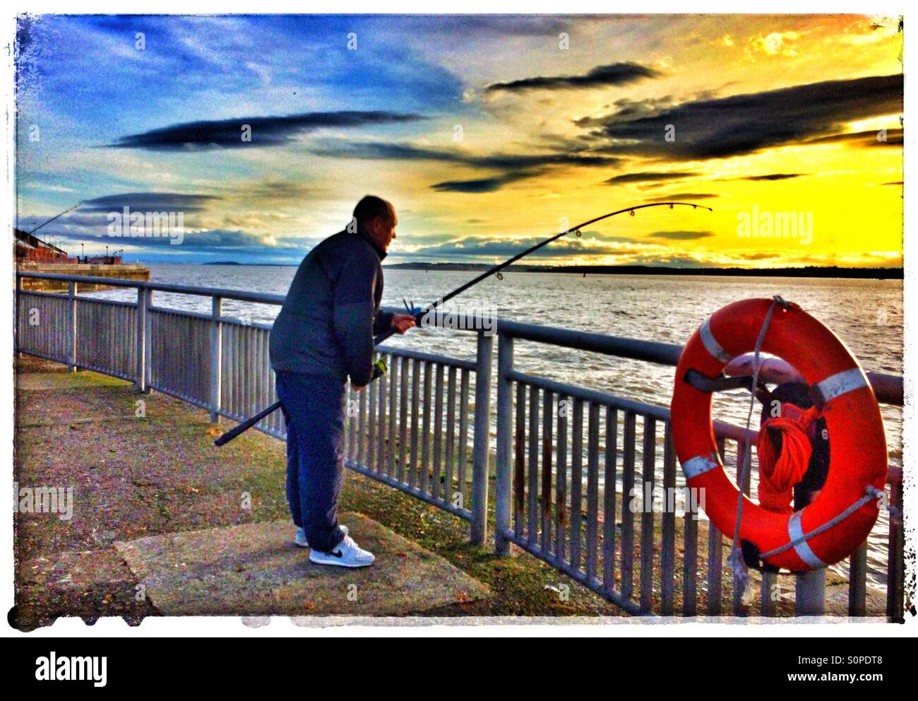 Fishing on the River Mersey Stock Photo