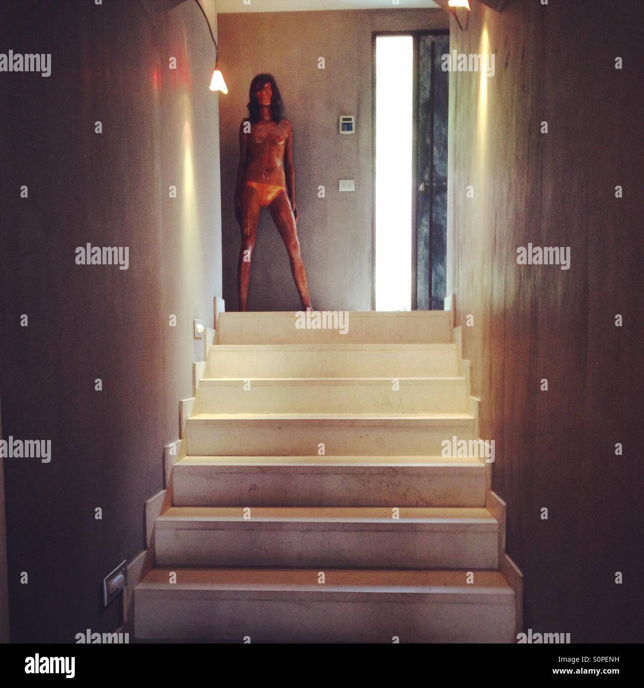 Hotel stairs with model sculpture - Stock Image