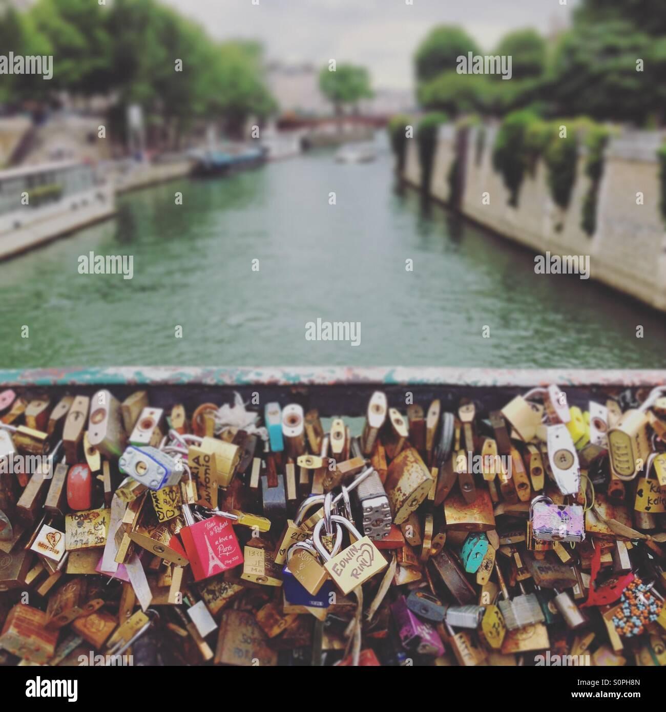 Love lock bridge and river Seine, Paris - Stock Image
