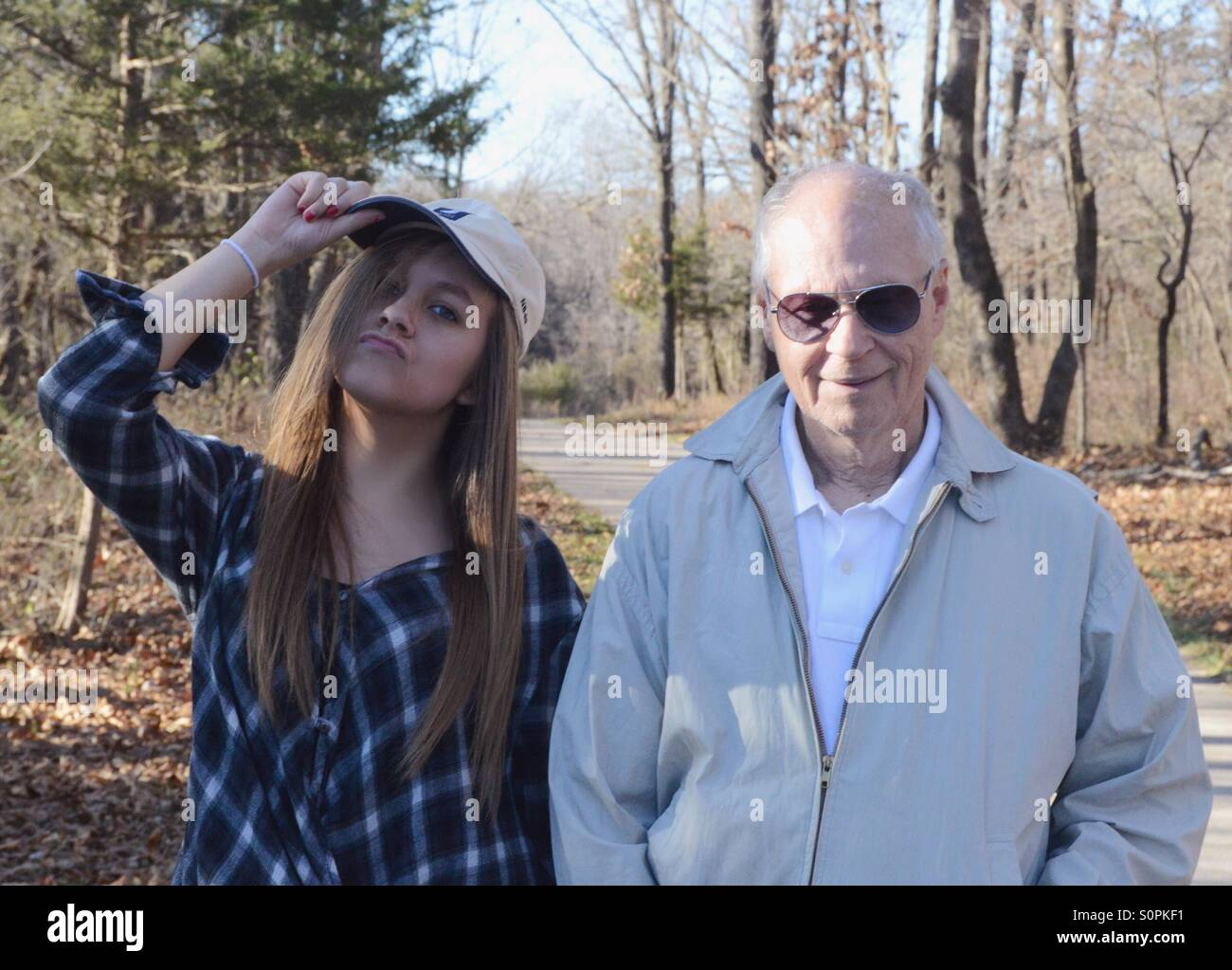 Cool girl with hat with grandpa - Stock Image