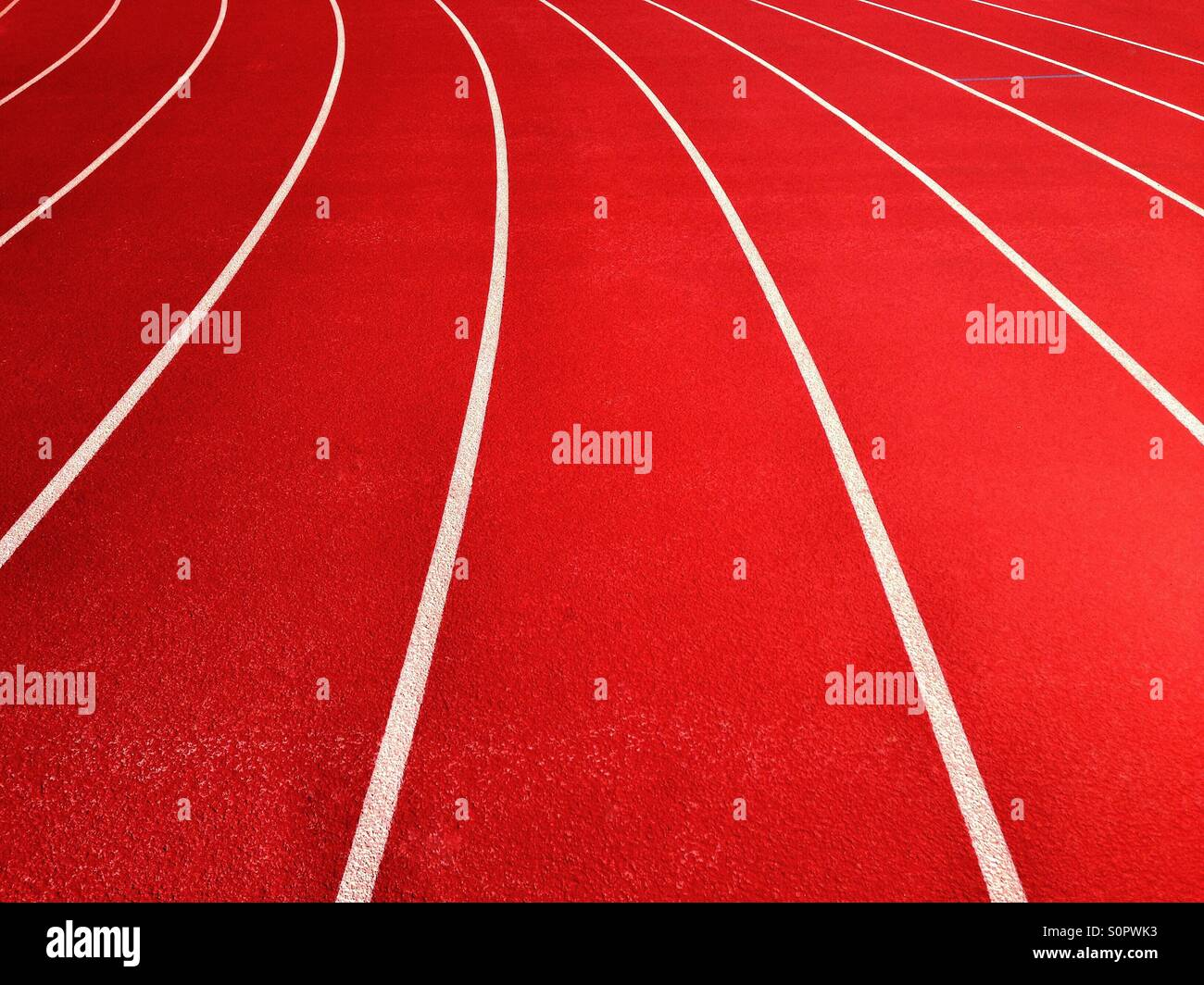 Lines on running track on sports field - Stock Image