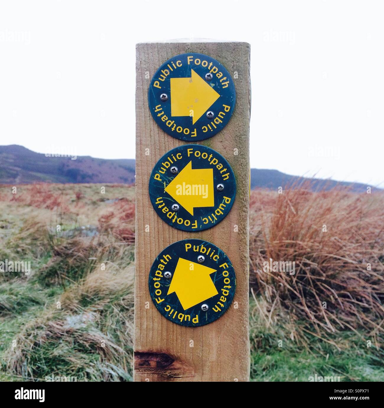 A sign for the various public footpaths across moorland in Northumberland, UK. - Stock Image