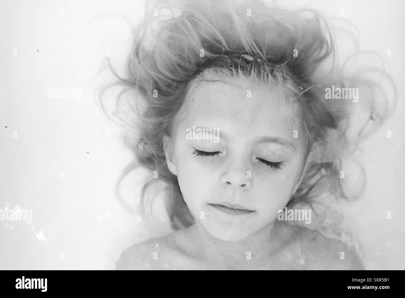 Girl in a bath - Stock Image