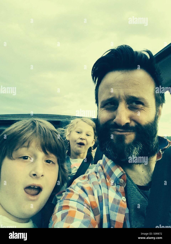 Family taking selfie in car - Stock Image