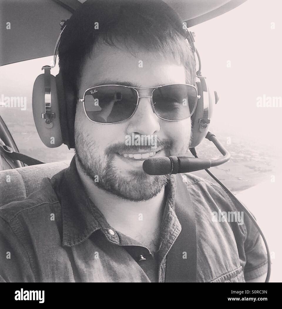 3a5e7d13ca Pilot Wearing Headset Stock Photos   Pilot Wearing Headset Stock ...