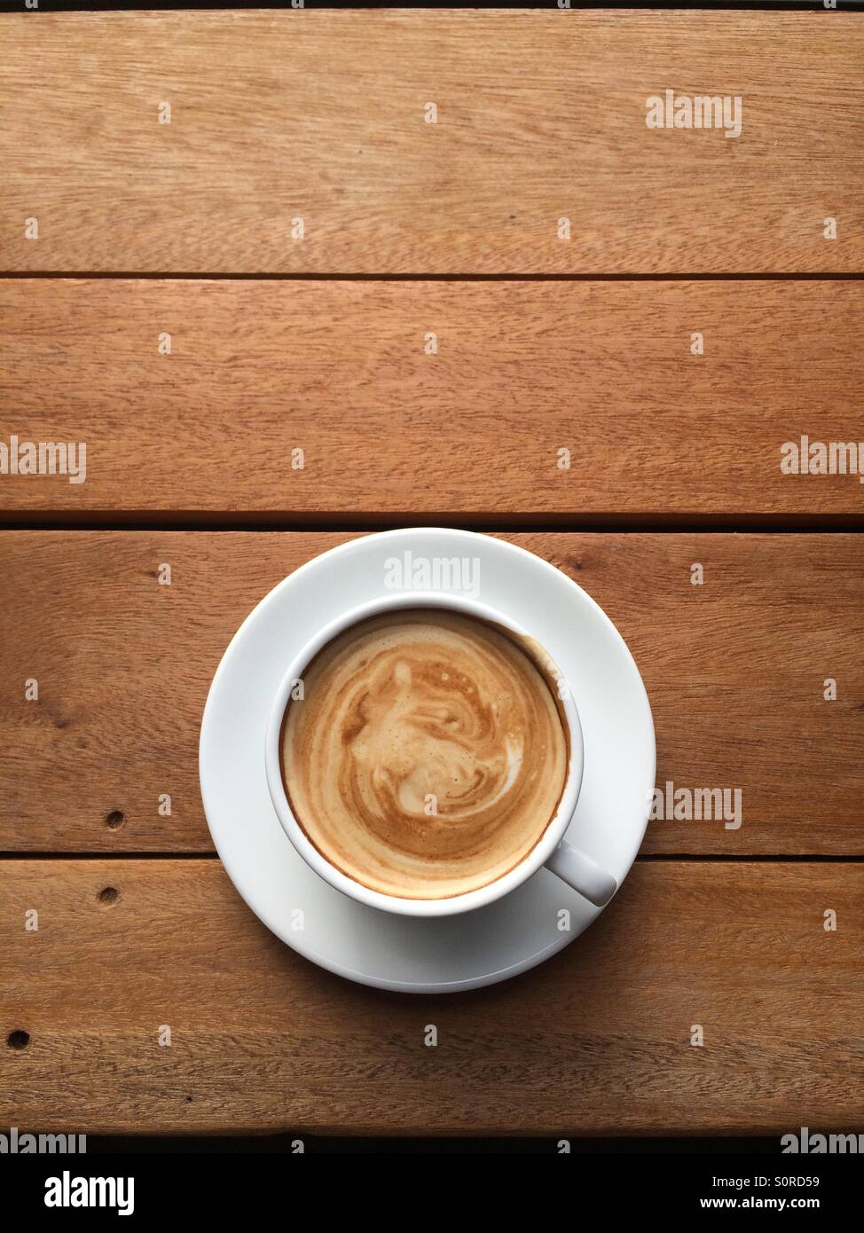 Hot latte cup of coffee. - Stock Image
