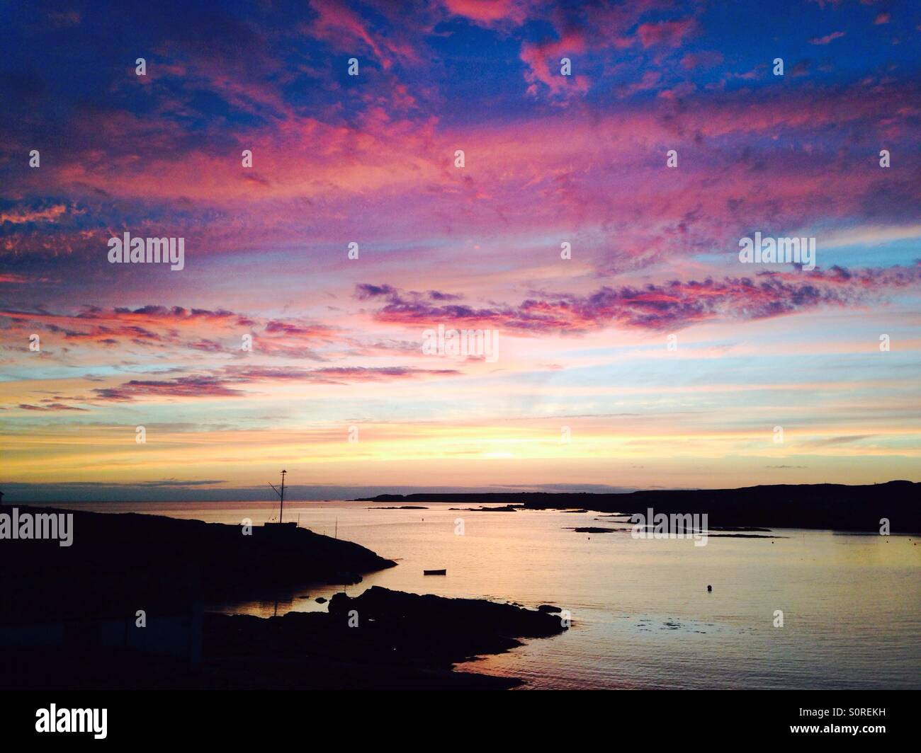 Sunset in Trearddur Bay, Anglesey - Stock Image