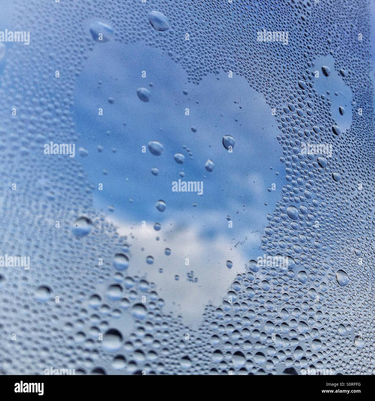 Heart shape made in condensation on window - Stock Image