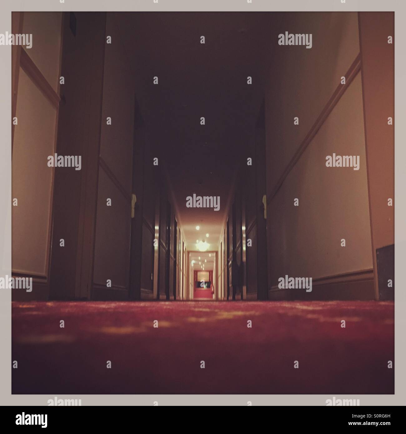 Deserted creepy hotel corridor - Stock Image