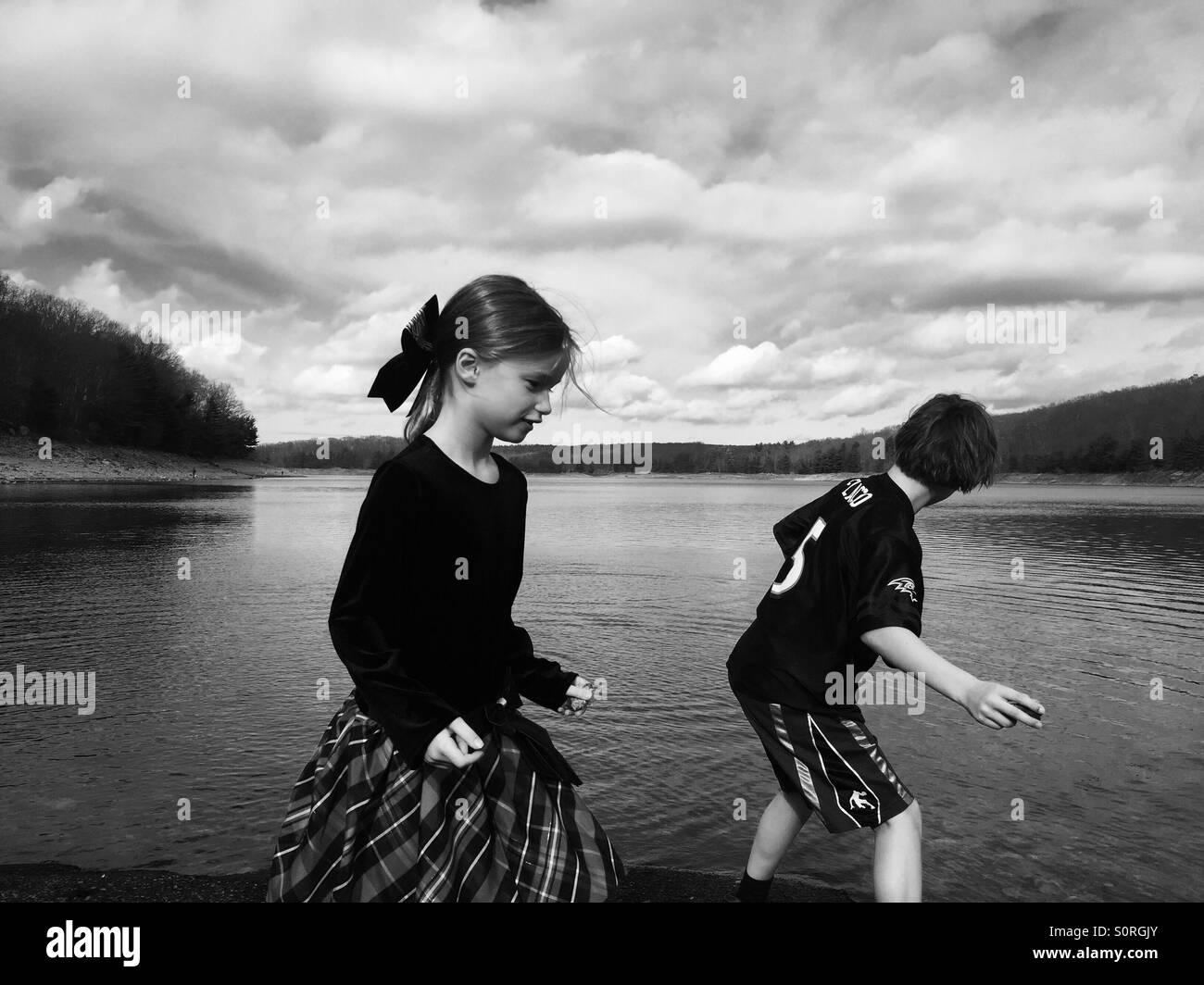 Children skipping stones - Stock Image
