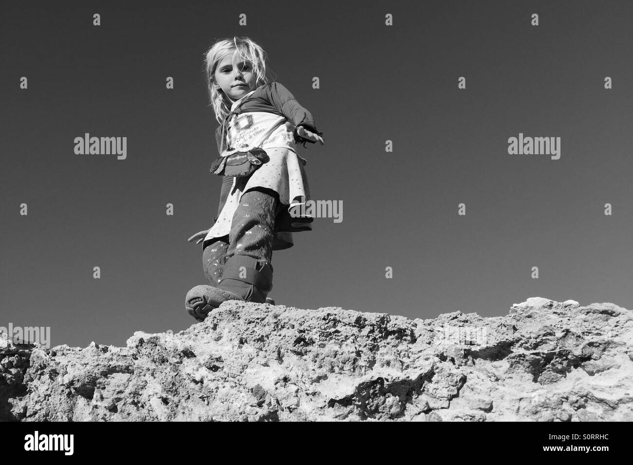 Girl getting ready to jump - Stock Image