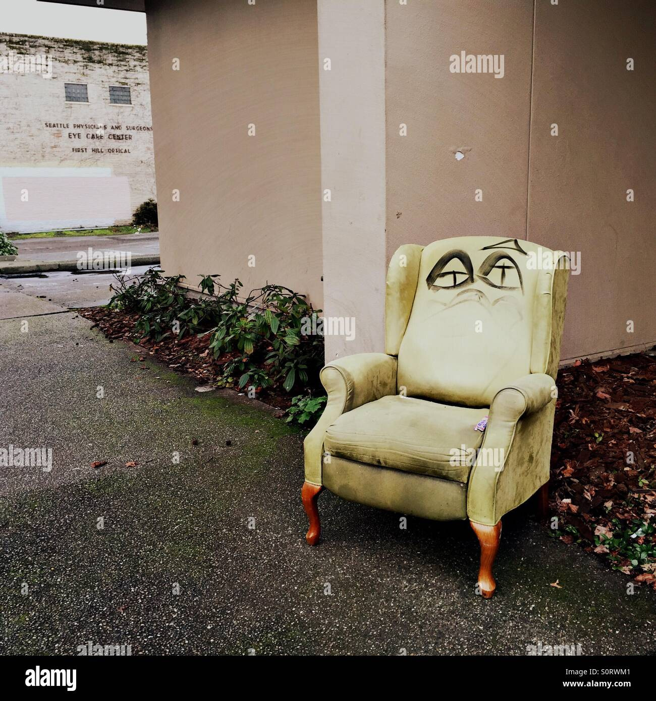 Old Wing Chair On The Street Corner   Stock Image