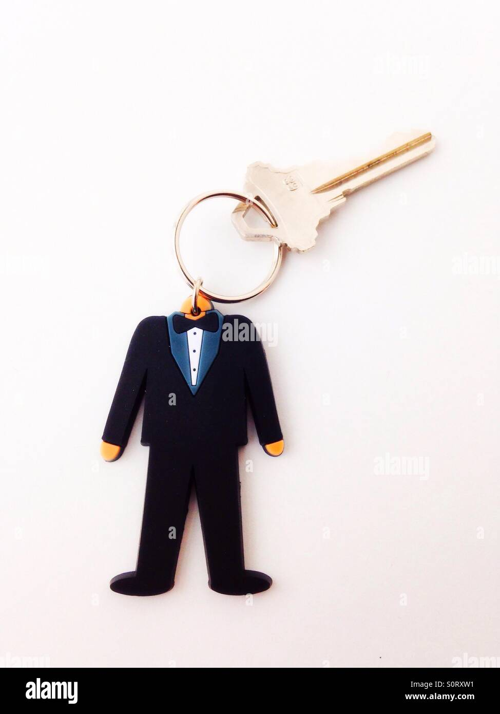 A key ring of a man in a tuxedo. - Stock Image
