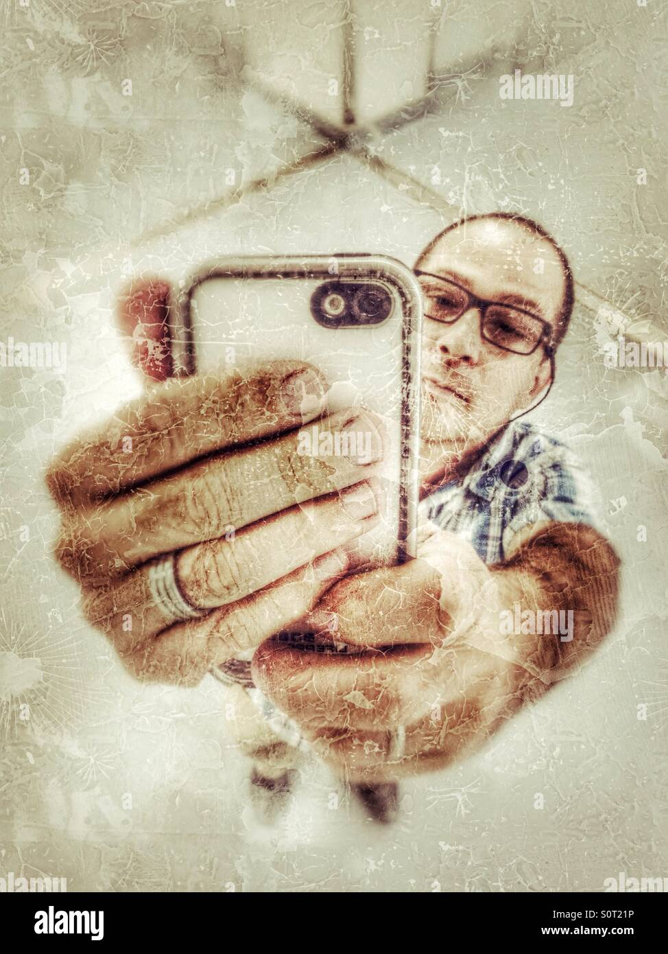 Selfie in a mirror. - Stock Image