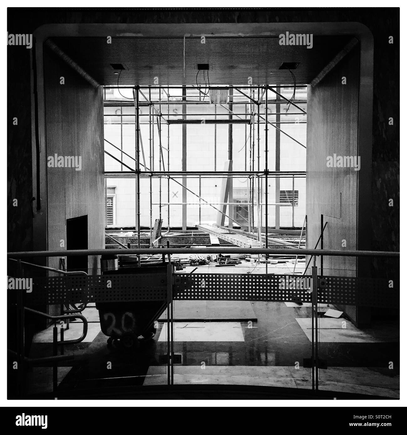 Black and white shot of renovations being done on a new downtown apartment building.   Pittsburgh. - Stock Image