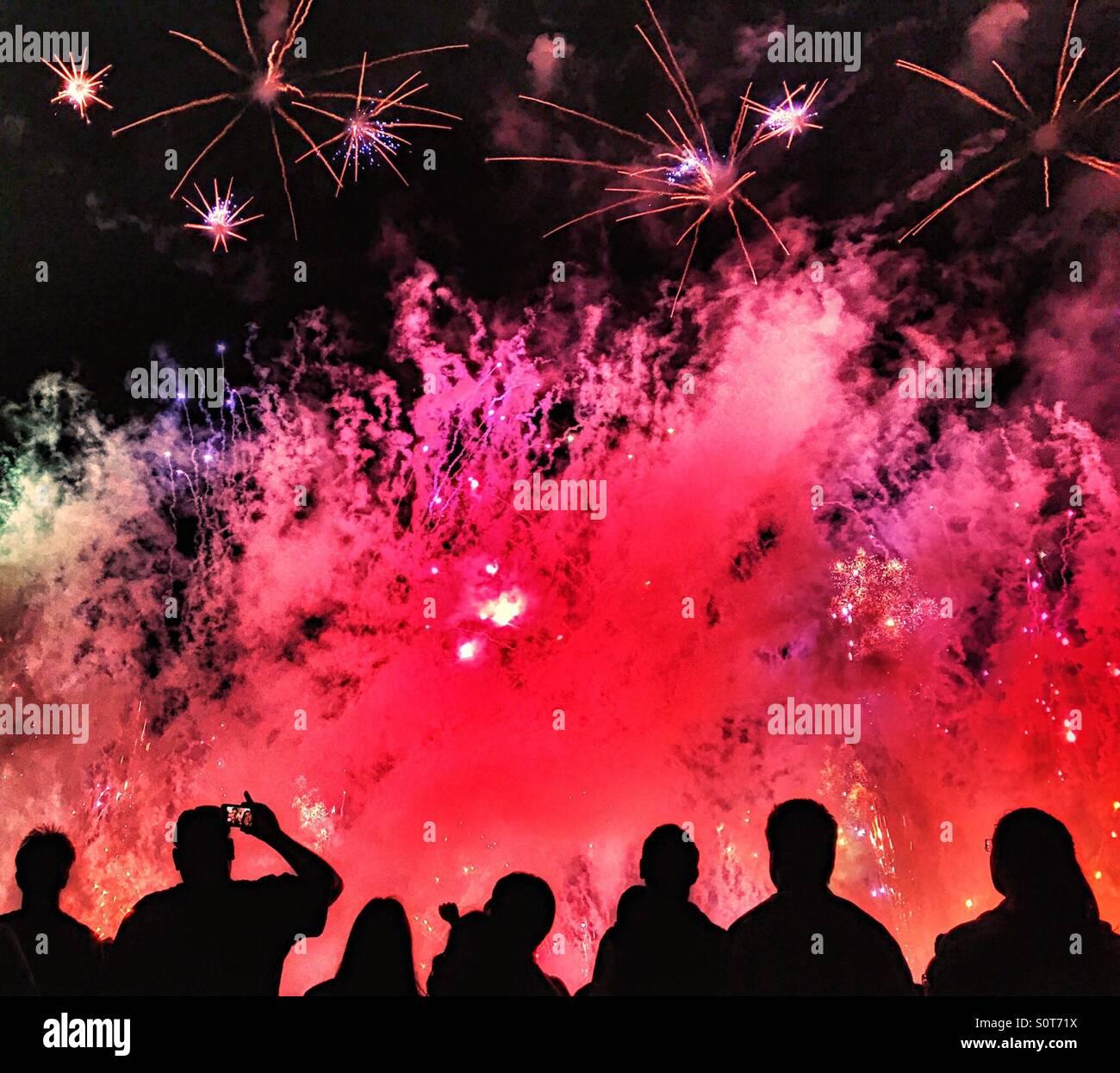 crowd watching fireworks - Stock Image