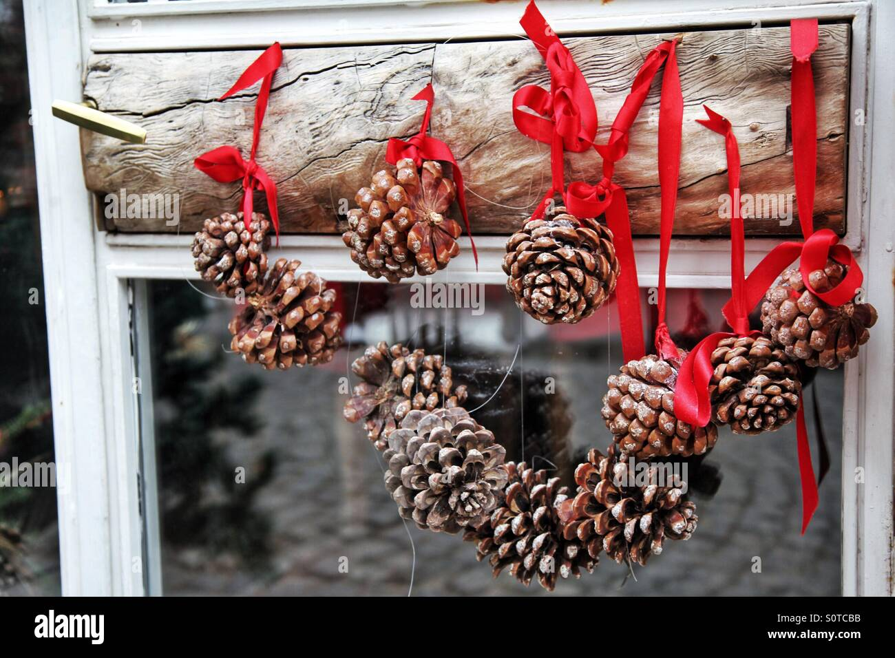 Cones are on the door with red ribbons - Stock Image
