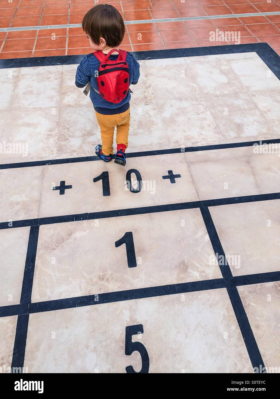 Boy with numbers - Stock Image